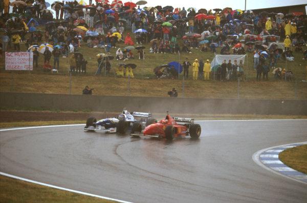 Catalunya, Barcelona, Spain.31/5-2/6 1996.Michael Schumacher (Ferrari F310) forces Jacques Villeneuve (Williams FW18 Renault) wide as he goes down the inside.Ref-96 ESP 09.World Copyright - LAT Photographic