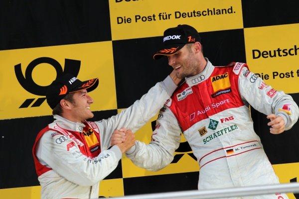 Congratulations for race winner Martin Tomczyk (GER), Audi Sport Team Phoenix, right, from Timo Scheider (GER), Audi Sport Team Abt (2nd), left.DTM, Rd4, Eurospeedway Lausitz, Germany, 18-19 June 2011.