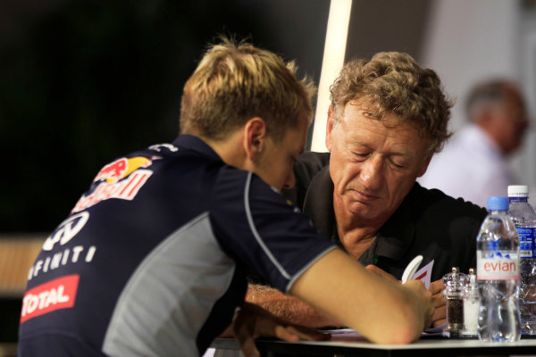 Marina Bay Circuit, Singapore. Saturday 21st September 2013. Sebastian Vettel, Red Bull Racing talks with F1 circuit designer Hermann Tilke. World Copyright: Charles Coates/LAT Photographic. ref: Digital Image _X5J9726
