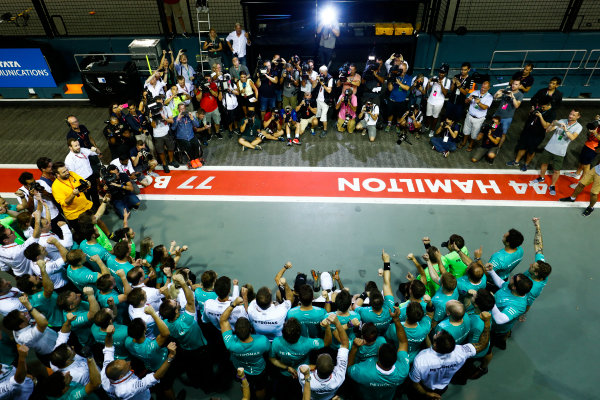 Marina Bay Circuit, Marina Bay, Singapore. Sunday 17 September 2017. Lewis Hamilton, Mercedes AMG, 1st Position, Valtteri Bottas, Mercedes AMG, 3rd Position, and the Mercedes team celebrate. World Copyright: Sam Bloxham/LAT Images  ref: Digital Image _W6I8302