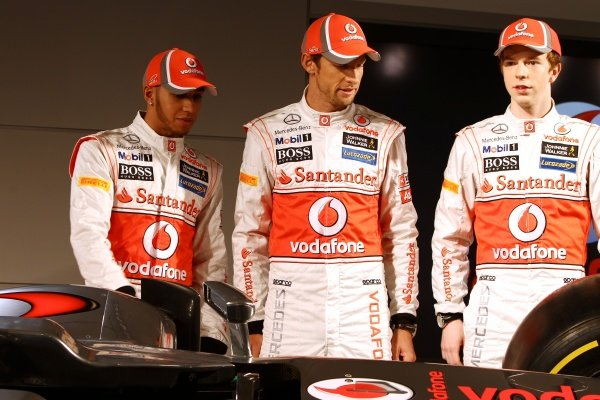 (L to R): Lewis Hamilton (GBR) McLaren; team mate Jenson Button (GBR) McLaren; Oliver Turvey (GBR), with the new McLaren MP4-27.