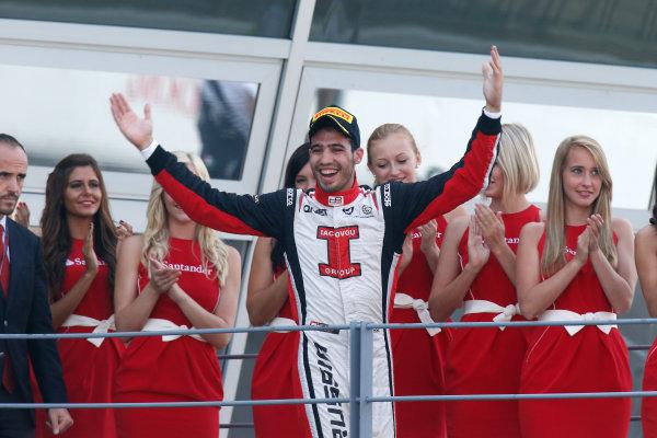 Autodromo Nazionale di Monza, Monza, Italy. Sunday 9th September 2012. Sunday Race 2.Race 2 winner Tio Ellinas (CYP, Marussia Manor Racing) celebrates on the podium. Portrait. World Copyright: Glenn Dunbar/LAT Photographic Ref: Digital Image _89P9253.jpg