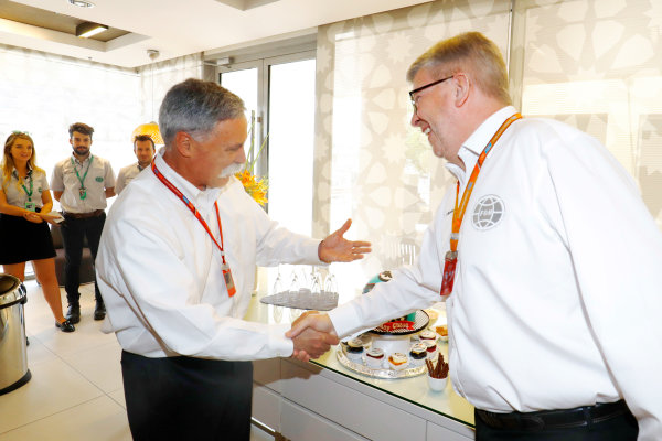 Yas Marina Circuit, Abu Dhabi, United Arab Emirates. Thursday 23 November 2017. Chase Carey, Chairman, Formula One, greets Ross Brawn, Managing Director of Motorsports, FOM. World Copyright: Steven Tee/LAT Images  ref: Digital Image _R3I1010
