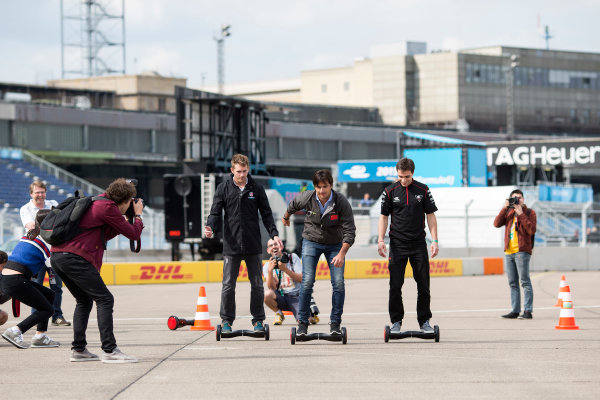 2014/2015 FIA Formula E Championship. Berlin ePrix, Berlin Tempelhof Airport, Germany. Thursday 21 May 2015 Scott Speed (USA)/Andretti Autosport - Spark-Renault SRT_01E, Nelson Piquet Jr (BRA)/China Racing - Spark-Renault SRT_01E and Jerome D'Ambrosio (BEL)/Dragon Racing - Spark-Renault SRT_01E on hovertrax. Photo: Andrew Ferraro/LAT/Formula E ref: Digital Image _FER0873