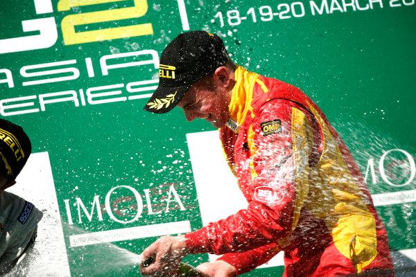 Imola, Italy. 20th March 2011. Sunday Race.Dani Clos, (ESP, Racing Engineering) celebrates victory on the podium. Portrait.   World Copyright: Drew Gibson/GP2 Media Service.ref: Digital Image _Y8P0588