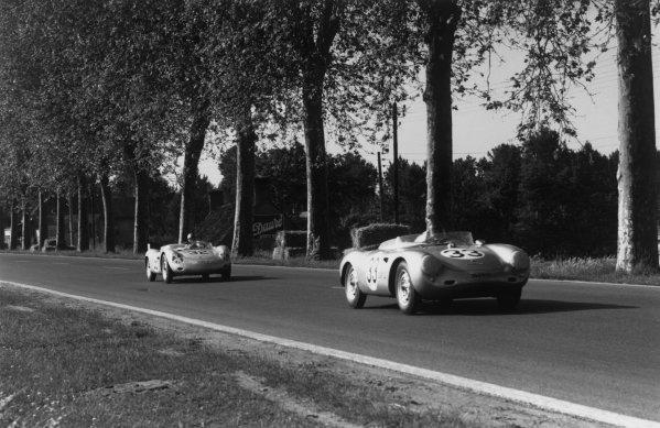 Le Mans, France. 22-23 June 1957.Hans Herrmann/Richard von Frankenberg (Porsche 550A RS), retired, leads Umberto Maglioli/Edgar Barth (Porsche 718 RSK), retired, in the paddock, action. World Copyright: LAT PhotographicRef: 459 - 18.