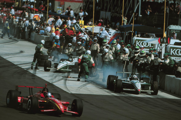 1999 CART Chicago GP, 22/8/99Montoya beats Franchitti and Tracy out of the pits-1999, Phil Abbott, USALAT PHOTOGRAPHIC