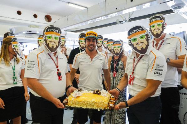 Fernando Alonso, McLaren is presented a birthday cake from the McLaren Team.