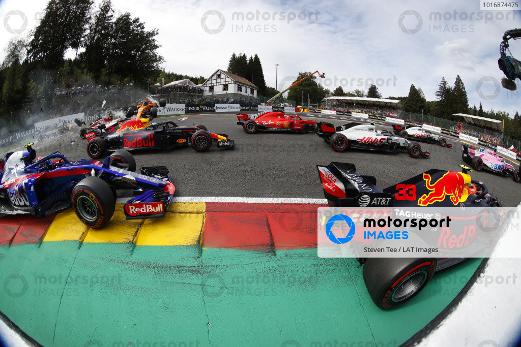 Fernando Alonso, McLaren MCL33, flies over Charles Leclerc, Alfa Romeo Sauber C37, after contact with Nico Hulkenberg, Renault Sport F1 Team R.S. 18. at the start. In the foreground, Max Verstappen, Red Bull Racing RB14, Kevin Magnussen, Haas F1 Team VF-18, Kimi Raikkonen, Ferrari SF71H, Daniel Ricciardo, Red Bull Racing RB14, and Pierre Gasly, Toro Rosso STR13.