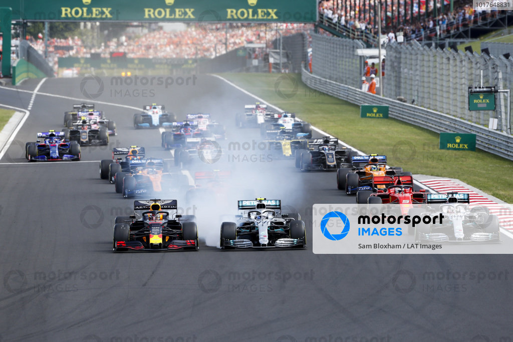 Max Verstappen, Red Bull Racing RB15 leads Valtteri Bottas, Mercedes AMG W10, Lewis Hamilton, Mercedes AMG F1 W10 and Sebastian Vettel, Ferrari SF90 at the start of the race
