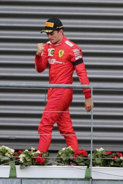 Charles Leclerc, Ferrari, 1st position, arrives on the podium