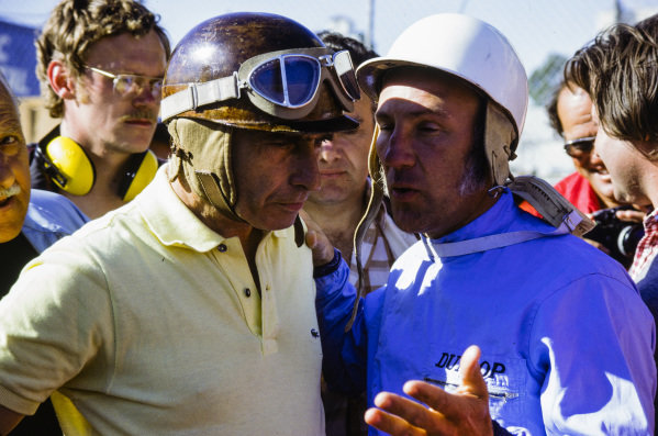 Racing legends Juan Manuel Fangio and Stirling Moss converse before a veterans' race.