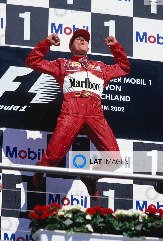 2002 German Grand Prix.Hockenheim, Germany. 26-28 July 2002.Michael Schumacher (Ferrari) does his celebratory trademark jump on the podium for his 1st position.Ref-02 GER 35.World Copyright - LAT Photographic