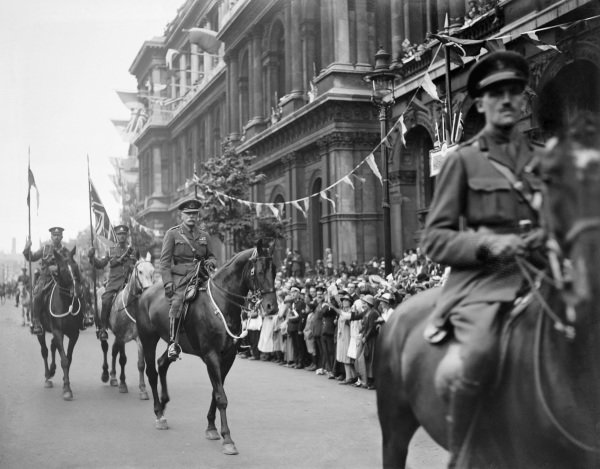 Officers on horseback parade down Whitehall during Peace Day celebrations in London.