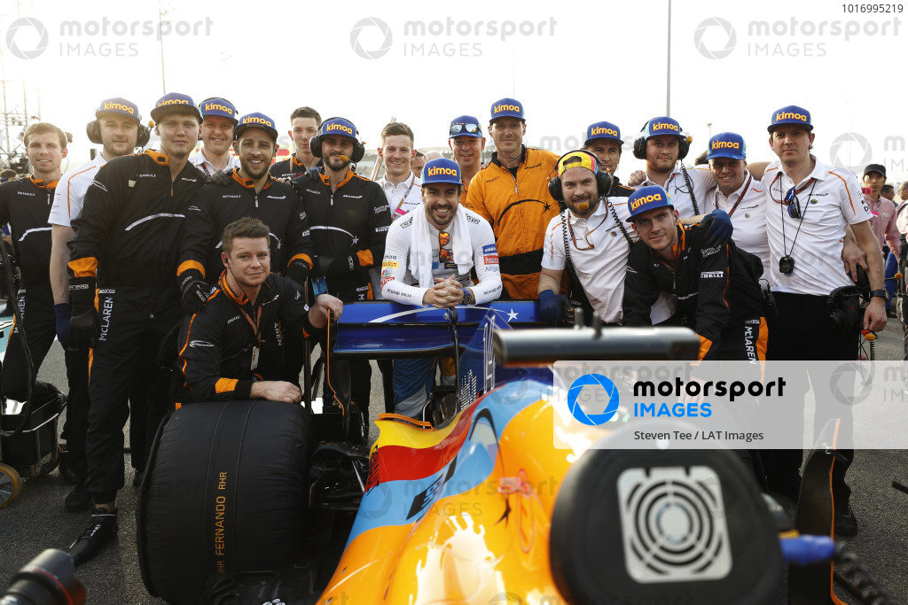 Fernando Alonso, McLaren, poses for a picture with his team on the grid
