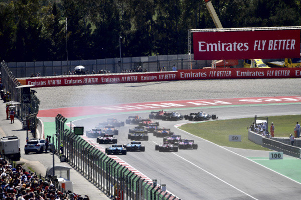 Valtteri Bottas, Mercedes AMG W10, battles with Lewis Hamilton, Mercedes AMG F1 W10, and Sebastian Vettel, Ferrari SF90, ahead of the field as they head through the first corner