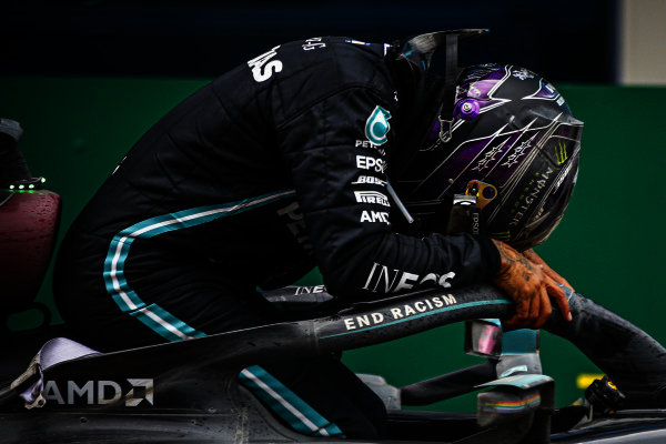 Lewis Hamilton, Mercedes-AMG Petronas F1, 1st position, arrives in Parc Ferme after securing his 7th world drivers championship title Lewis Hamilton, Mercedes-AMG Petronas F1, climbs out of his car after winning the race, to take his 7th World Championship title