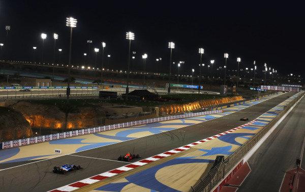Sergio Perez, Red Bull Racing RB16B, leads Esteban Ocon, Alpine A521