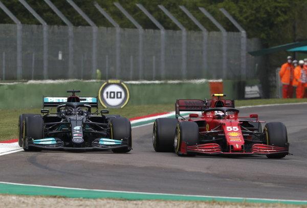 Carlos Sainz, Ferrari SF21, leads Sir Lewis Hamilton, Mercedes W12