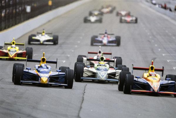 Robbie Buhl, Dreyer & Reinbold Racing, Dallara IR-03 Chevrolet, battles with Buddy Rice, Cheever Racing, Dallara IR-03 Chevrolet. They lead Tony Renna, Kelley Racing, Dallara IR-03 Toyota.