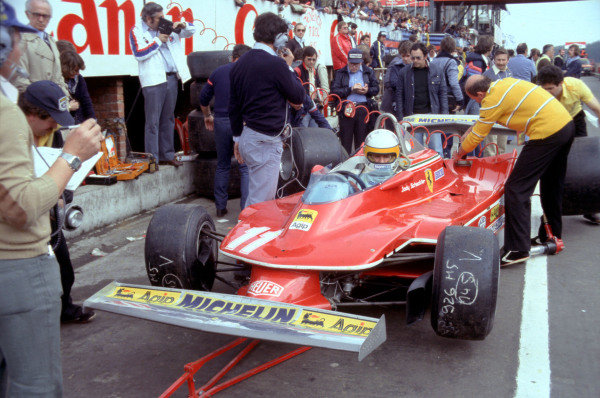 Mechanics work on the rear of Jody Scheckter's Ferrari 312T4.