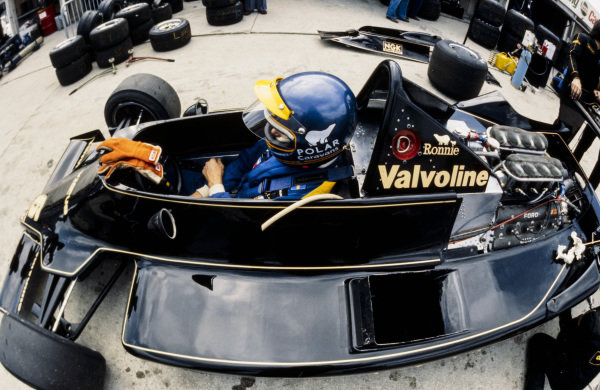 Ronnie Peterson sits in the cockpit of his Lotus 79 Ford in the pitlane.
