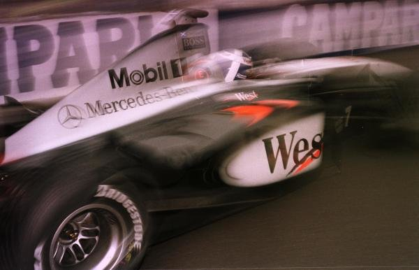 1998 Italian Grand Prix.Monza, Italy.11-13 September 1998.David Coulthard (McLaren MP4/13 Mercedes-Benz) pulls out of the pits.World Copyright - LAT Photographic