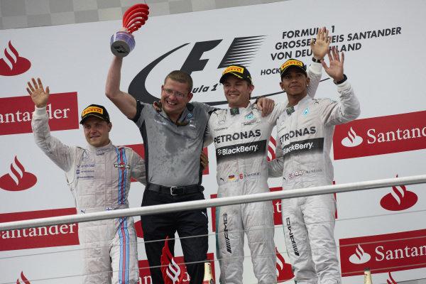 Valtteri Bottas, 2nd position, Simon Cole, Mercedes, Nico Rosberg, 1st position, and Lewis Hamilton, 3rd position, on the podium.
