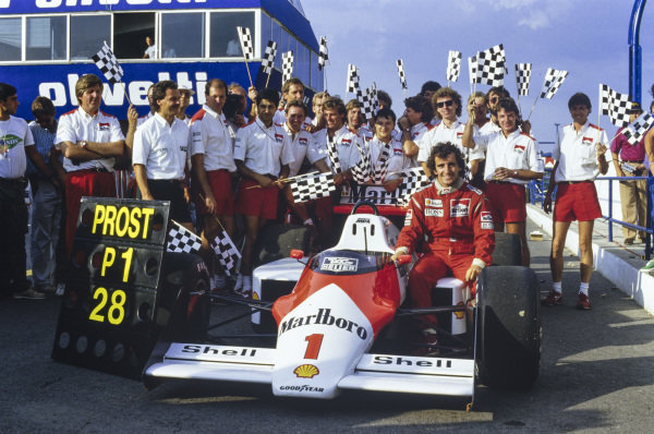 Alain Prost, stood beside his McLaren MP4-3 TAG, celebrates with team members and a pit board to commemorate his victory in the Portuguese Grand Prix. The result gave Prost a record 28 grand prix wins, surpassing Jackie Stewart's long-standing previous record of 27.