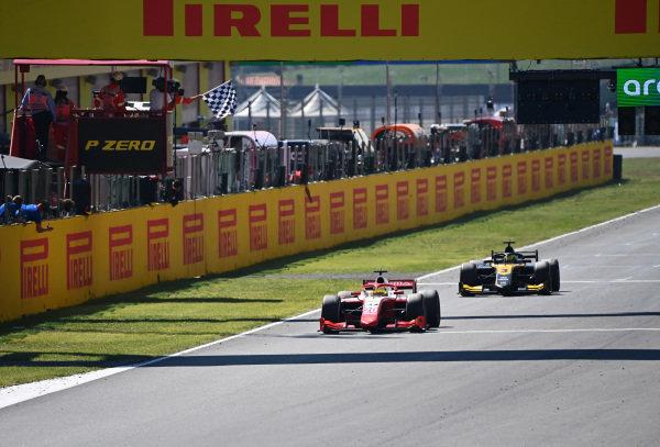 Mick Schumacher (DEU, PREMA RACING) leads Guanyu Zhou (CHN, UNI-VIRTUOSI) across the line
