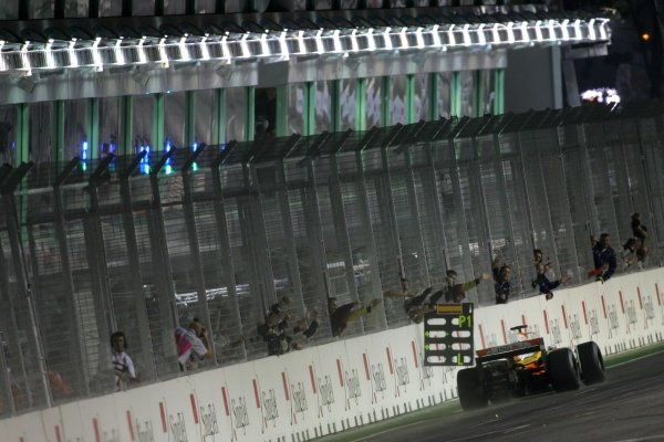 Race winner Fernando Alonso (ESP) Renault R28 crosses the line to win the race.