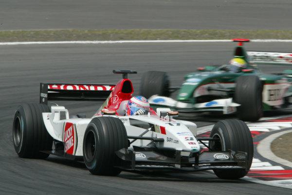 2003 European Grand Prix - Sunday RaceNurburgring, Germany.29th June 2003.Jenson Button, B-A-R Honda 005, leads Mark Webber, Jaguar R4, action.World Copyright LAT Photographic.Digital Image Only.