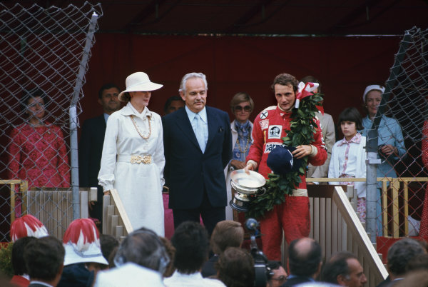 Monte Carlo, Monaco. 27th - 30th May 1976. HSH Prince Rainier and Princess Grace stand with the winner, Niki Lauda (Ferrari 312T2), 1st position, on the podium, portrait.  World Copyright: LAT Photographic.  Ref: 76 MON 53.