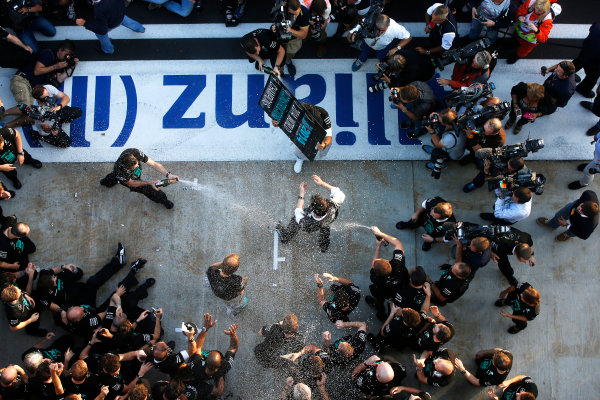 Sochi Autodrom, Sochi, Russia. Sunday 12 October 2014. The Mercedes team celebrate becoming the 2014 Constructors world champions. World Copyright: Charles Coates/LAT Photographic. ref: Digital Image _J5R4054