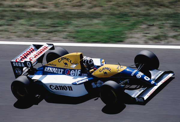 1993 Hungarian Grand Prix.Hungaroring, Budapest, Hungary.13-15 August 1993.Damon Hill (Williams FW15C Renault) 1st position for his maiden Grand Prix win.Ref-93 HUN 15.World Copyright - LAT Photographic