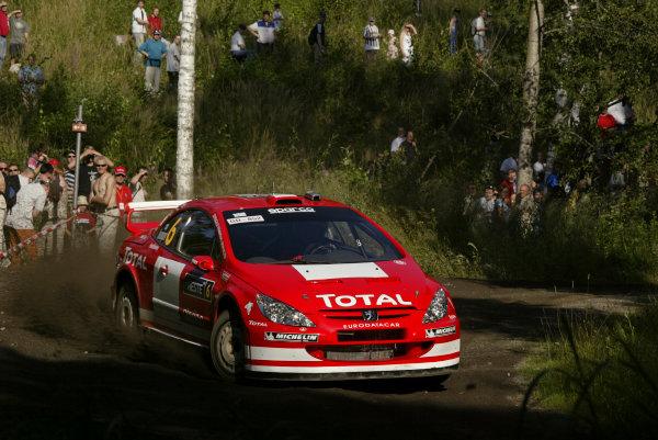 2004 FIA World Rally Champs. Round nine, Neste Rally Finland.5th - 8th August 2004.Harri Rovanpera, Peugeot, action.World Copyright: McKlein/LAT