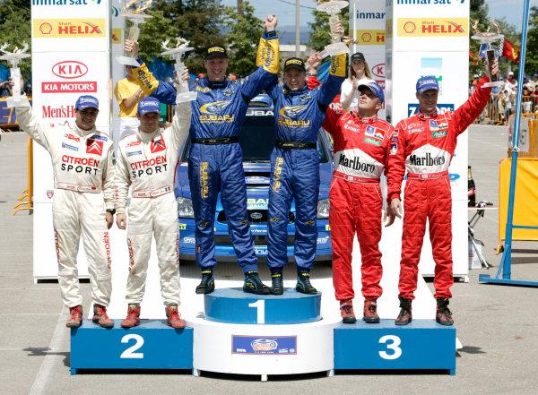 2004 FIA World Rally Champs. Round six, Acropolis Rally.3rd-6th June 2004.Solberg, Loeb, Rovanpera podium.World Copyright: McKlein/LAT