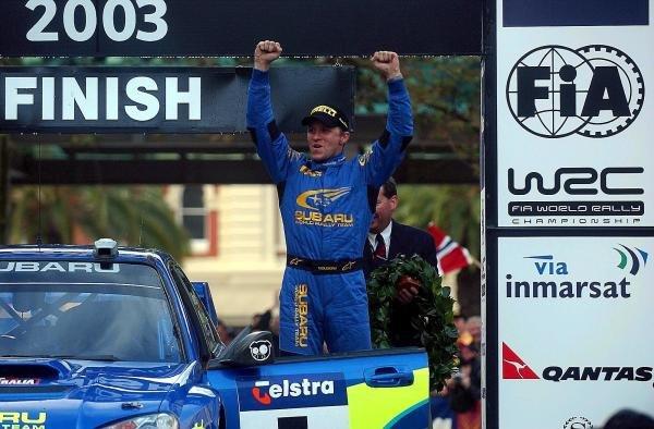 (L to R): Rally winner Petter Solberg (NOR) Subaru celebrates victory on the podium.World Rally Championship, Rd10, Telstra Rally Australia, Day Three, Perth, Australia, 7 September 2003.DIGITAL IMAGE