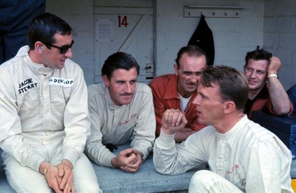 (Left to right) Jackie Stewart (GBR) BRM, Graham Hill (GBR) BRM and Dan Gurney (USA) Eagle, chat before the race. Belgian Grand Prix, Spa, Belgium, 12 June 1966.