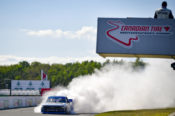 #24: Brett Moffitt, GMS Racing, Chevrolet Silverado celebrates with a burnout after winning