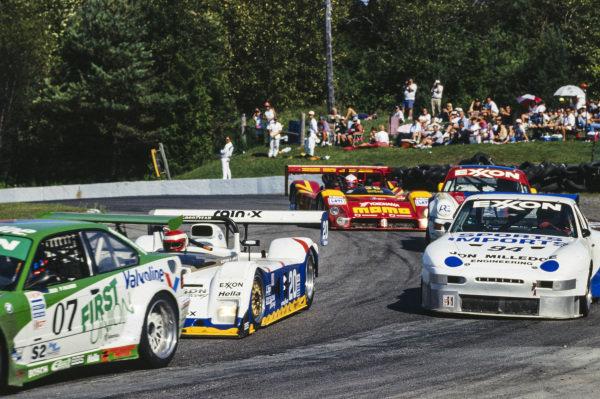 Bill Auberlen / Pete Halsmer / Javier Quiros / Boris Said, Prototype Technology Group, BMW M3 E36, leads John Paul, Jr. / Butch Leitzinger, Riley & Scott Mk III Ford, and Nathan Ulrich, Porsche 968.