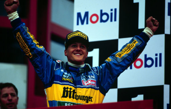 1995 Belgian Grand Prix.Spa-Francorchamps, Belgium.25-27 August 1995.Michael Schumacher (Benetton Renault) 1st position, celebrates winning the race from 17th on the grid.World Copyright - LAT Photographic