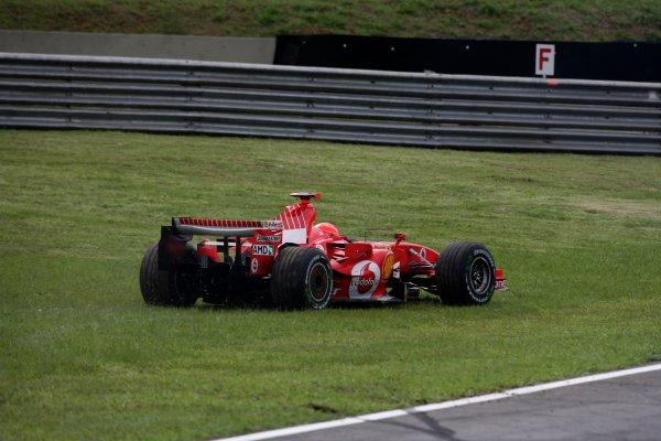 2006 Brazilian Grand Prix - Friday Practice Interlagos, Sao Paulo, Brazil. 19th - 22nd October 2006. Michael Schumacher, Ferrari 248F1, spins off, action. World Copyright: Charles Coates/LAT Photographic ref: Digital Image ZK5Y9047
