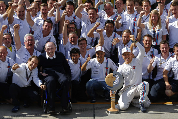 Frank Williams (GBR) Williams Team Owner and the team celebrate third place for Valtteri Bottas (FIN) Williams and fourth place for Felipe Massa (BRA) Williams. Formula One World Championship, Rd8, Austrian Grand Prix, Race, Spielberg, Austria, Sunday 22 June 2014.