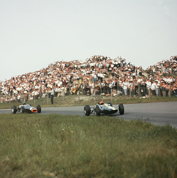 Zandvoort, Holland.22-24 May 1964.Peter Arundell (Lotus 25 Climax) leads Graham Hill (BRM P261). They finished in 3rd and 4th positions respectively.Ref-3/1230.World Copyright - LAT Photographic