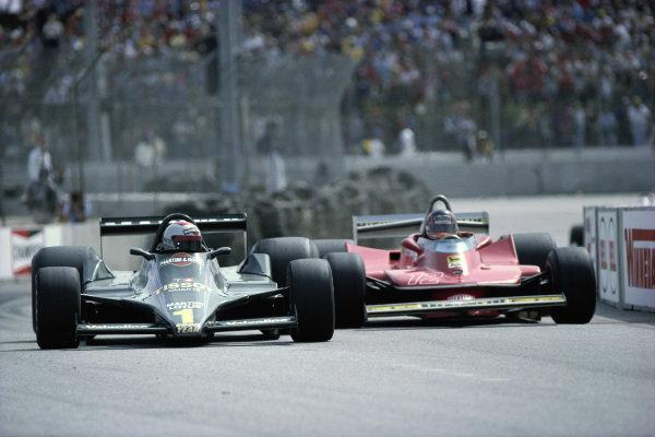 Mario Andretti, Lotus 79 Ford, leads Gilles Villeneuve, Ferrari 312T4.