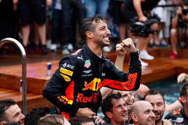 Daniel Ricciardo, Red Bull Racing, celebrates victory in the swimming pool on the Red Bull Energy Station.