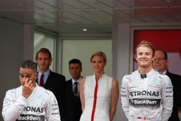 Monte Carlo, Monaco. Sunday 25 May 2014. Lewis Hamilton, Mercedes AMG, 2nd Position, and Nico Rosberg, Mercedes AMG, 1st Position, on the podium. World Copyright: Charles Coates/LAT Photographic. ref: Digital Image _N7T9869