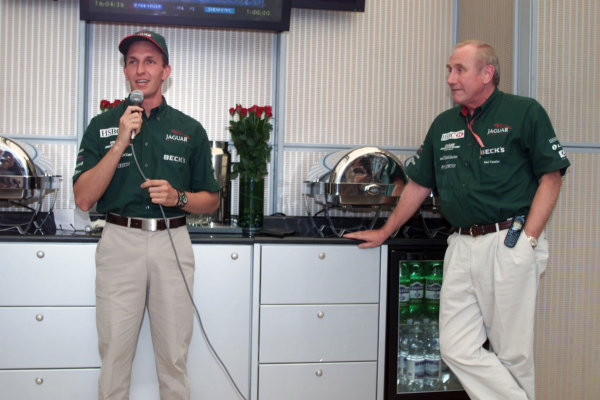 Monza, Italy. 8-10 September 2000.Jaguar announces Luciano Burti will be driving for them next season. Luciano Burti with Jaguar Racing Chairman Neil Ressler.World Copyright - Lawrence/LAT Photographic