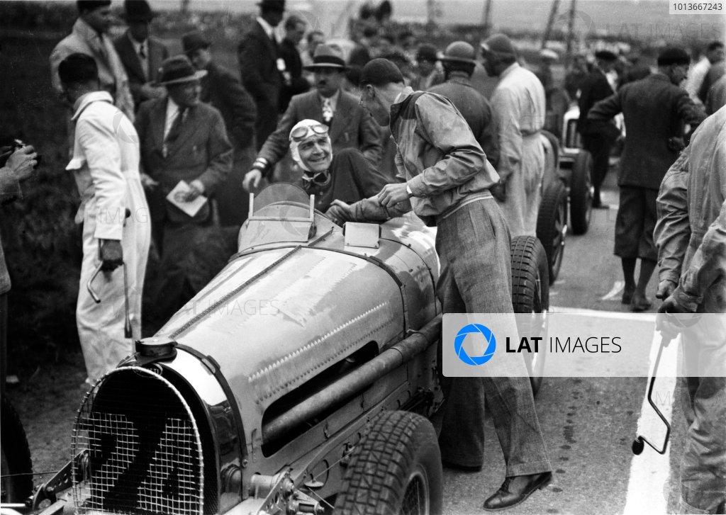 Peronne, France. 26 May 1935.Robert Benoist, Bugatti T59, 1st position, on the grid, portrait, helmet.World Copyright: Robert Fellowes/LAT PhotographicRef: 35PIC10